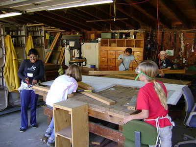 Deer Hollow Farm, Rancho San Antonio OSP  An area girls middle school prepping a door to be used for the cow shed. These are our future Open Space Technicians.