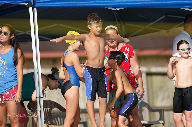 Elias high-fiving Sienna for beating him one on one in the breast stroke.