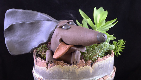 Pieces can also be used separately....here the dog is shown in a pot I made. (The pot isn't included in the auction..).