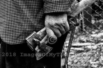 A man holds tools in his hand in the village of Ushguli in Svaneti, Georgia, part of a recognized UNESCO World Heritage Site. Located at an altitude of 2,100 meters near the foot of Shkhara, one of the highest summits of the Greater Caucasus mountains, Ushguli is one of the highest continuously inhabited settlements in Europe. It is home to 70 families and covered in snow for 6 months of the year. Often the road to Mestia is impassable. Ushguli shares the Svaneti region traditional koshki, defensive stone structures built from the 9th century onward and is known for it's architectural treasures and picturesque landscapes.