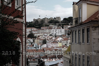 A view of Alfama through narrow streets of Lisbon. Alfama is the oldest district of Lisbon, on the slope between the Sao Jorge Castle and the Tejo river.