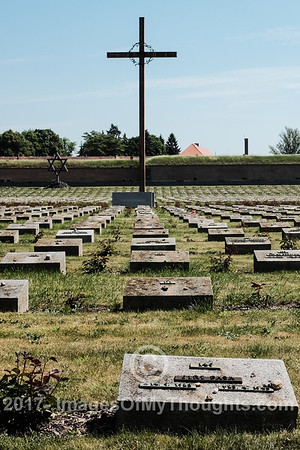 A cross and a Star of David dominate the Terezin Memorial Cemetery, Národní hřbitov Terezín, for victims murdered in the area by the Nazis in World War Two.