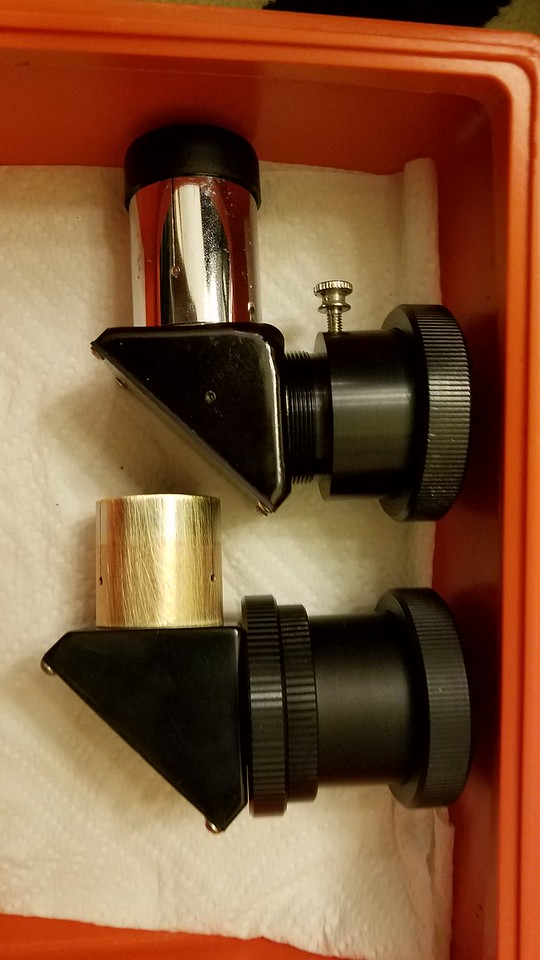 """2x 1.25"""" Diagonals with SCT adapters. One, the lower one has a strange lens attached to it by the Diagonal."""