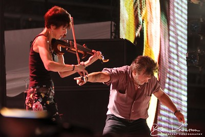 Miriam Sturm with John Mellencamp at the Farm Aid 26th Anniversary Concert at Livestrong Sporting Park on August 13, 2011 in Kansas City, Kansas