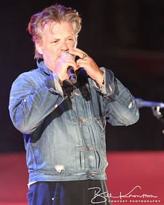 John Mellencamp introduces Neil Young at the Farm Aid 26th Anniversary Concert at Livestrong Sporting Park on August 13, 2011 in Kansas City, Kansas