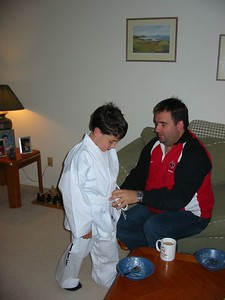Jason helping out Thomas with his taekwondo outfi.