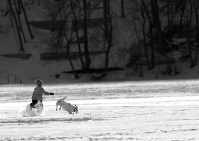 Medicine Lake, Running with her friend...Kid and Dog..Unknown  ©JLCramerPhotography 2009