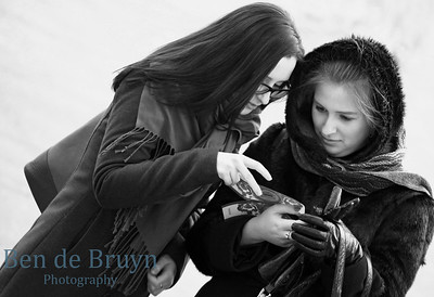 Two girls looking at theater tickets at Bolshoi theater