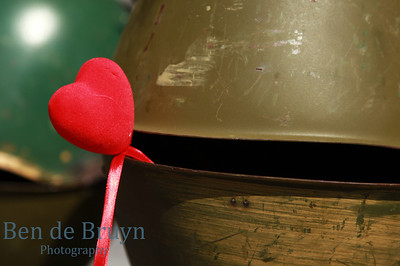 Remembering the war heroes with a red heart shape with second world war helmets