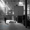 Factory worker walking in areated cement brick factory near Moscow