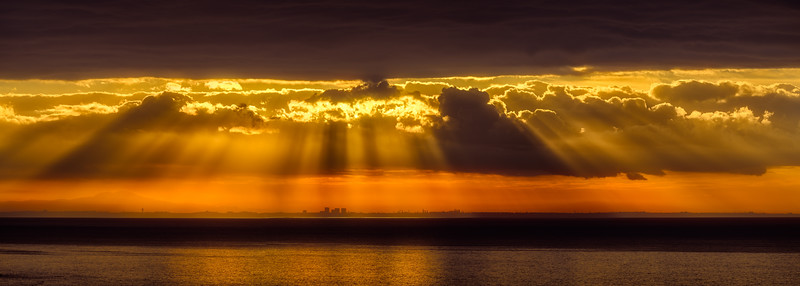 Early morning sun rays dramatically fall over Los Angeles
