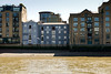 Wharf buildings and bridge from the Thames