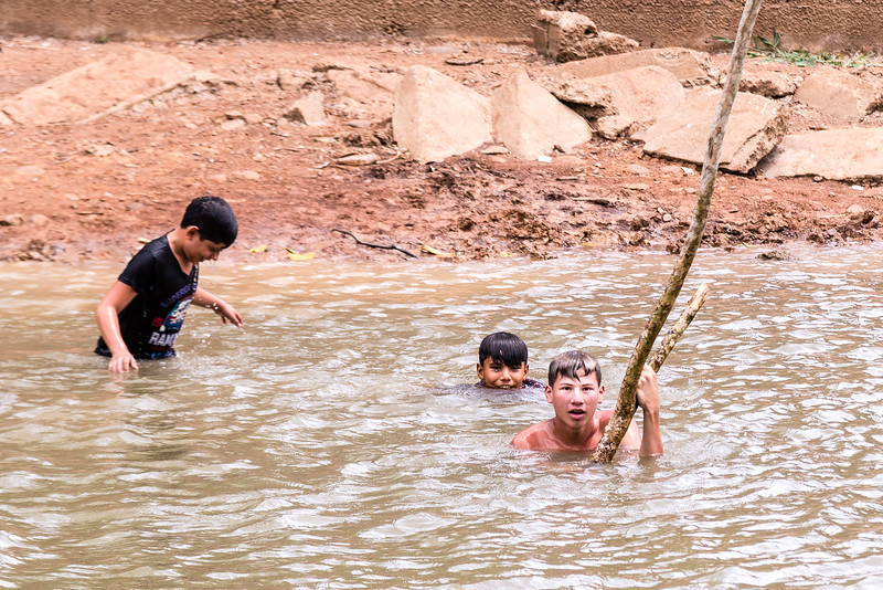 Kids playing in the Rio Frio river in the Caño Negro Wildlife Refuge near the town of Los Chiles