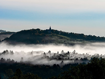 Church on the hill and beautiful white fog with sun rays, Alsace