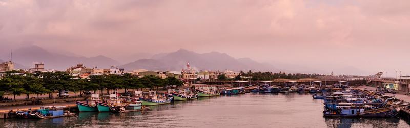 Sea, mountains, boats.