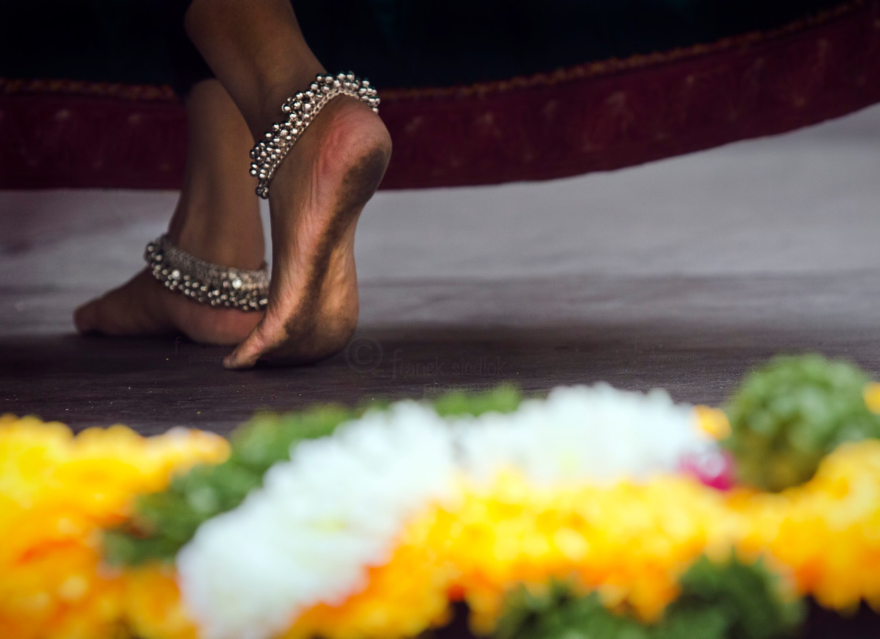 ...and with feet ornamented with traditional jewelry featuring prominently during the dances.
