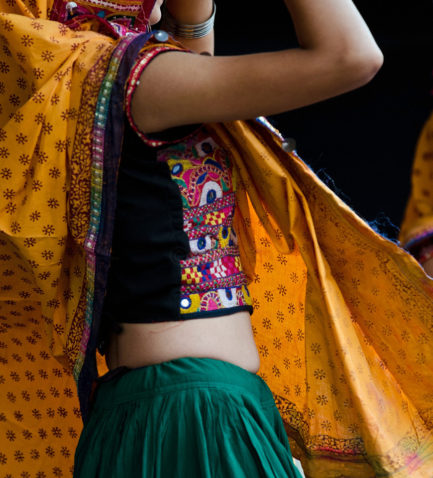 The loose and colourful cloths swirl and swish adding to the dynamics of the celebrations...