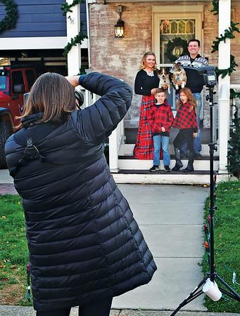 SARAH GOLDMAN, FRONT STEPS PROJECT-3<br /> <br /> Sarah Goldman photographs Arlington residents Emilie, Ben, Samantha and Reid Heller and their pets Nov. 24 for the Front Steps Project. (Photo by Brian Trompeter)