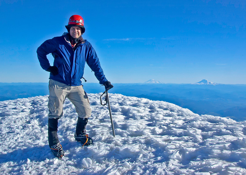 On the summit with Mount Ranier (L) and Mount Adams (R) in the distance.