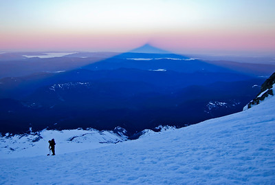 In the early morning light, Mount Hood creates a vast shadow