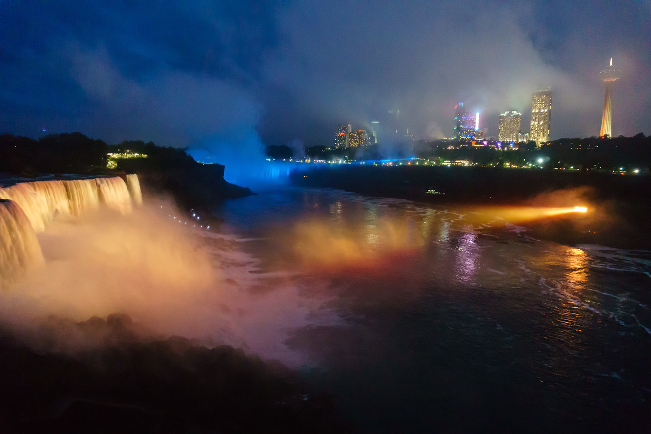 American falls on the left, Canada to the right and Horsehoe falls bathed in blue at the far end