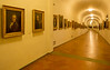 Corridor interior narrows as it approaches the Pitti Palace