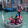 Gondola and gondolier coming in to pick up tourists at Santa Maria del Giglio on the Canale Grande