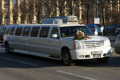 Another stretched limo with newly weds