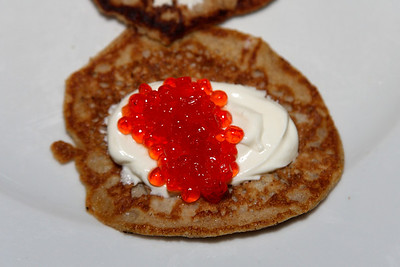 Blini with salmon eggs