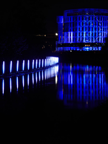 Reflection of light art on the  kennis gebouw (=knowledge building) of the University in the river 'Dommel'