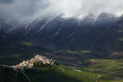 The village of Castellucio against the snowy mountains