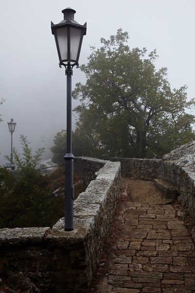 The walls of San Marino in the mist