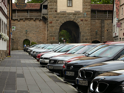 A typical German medieval town with BMW, Mercedes, audi and the like