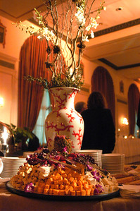Our new coral urns dressed the central two hors d'oeuvre tables, filled with curly willow and phaeleonopsis orchids.