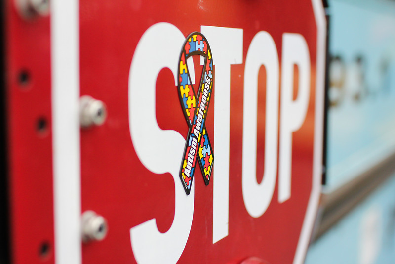An Autism Awareness ribbon adds character to the stop sign on the Jack FM radio bus.
