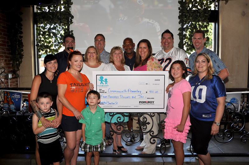 Check presented to Fullerton Cares members from Former NFL Rams Mike Lansford and Leroy Irvin and Swipe4TheKids