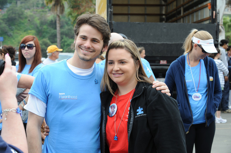 Jason Ritter of TV series Parenthood poses with a Autism Walk volunteer