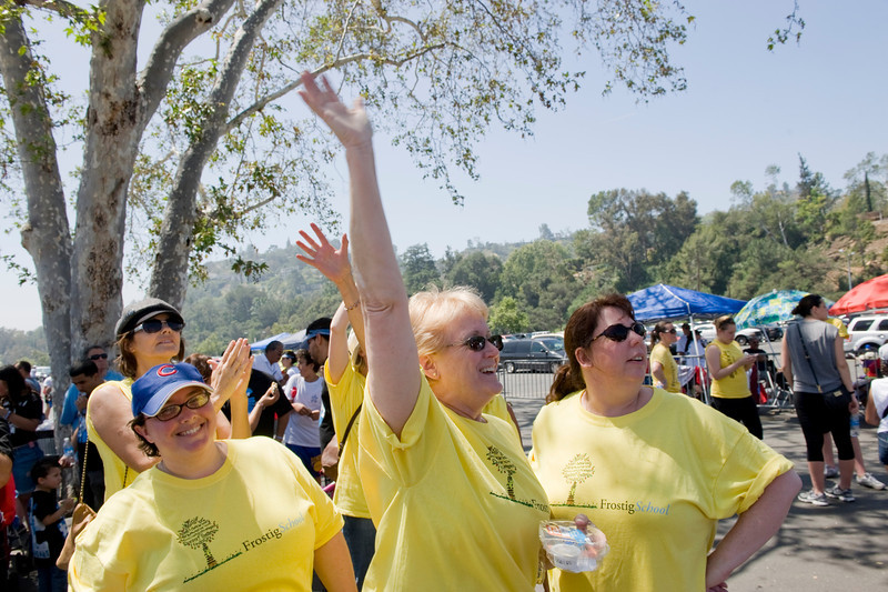 Team Frostig members cheer each other on at the finish of the Rose Bowl loop during Saturday's Los Angeles Walk Now for Autism Speaks event at the Rose Bowl.