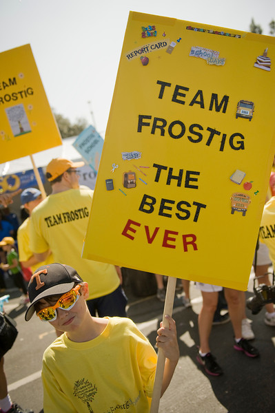 Nick Laughery, 10, of Pasadena, holds up a Team Frostig sign before heading out for Saturday's Los Angeles Walk Now for Autism Speaks at the Rose Bowl.