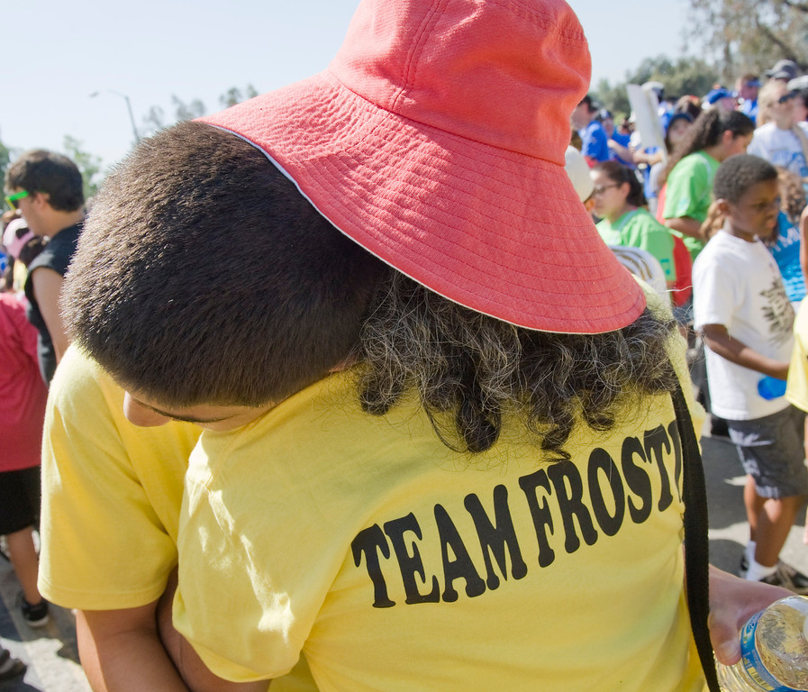 Daniel Moses, 13, of Glendale gets a hug from his mother, Ita, as he gets ready to make the Rose Bowl loop with Team Frostig  during Saturday's Los Angeles Walk Now for Autism Speaks at the Rose Bowl.