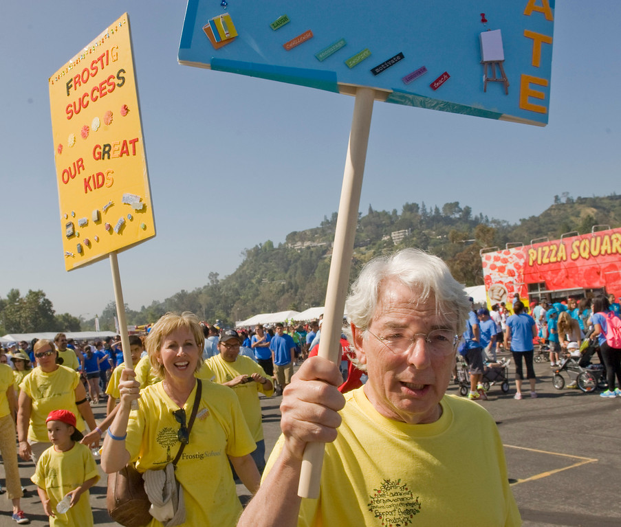 Author Monica Holloway, left and The Frostig Center Executive Director, Bennett Ross lead Team Frostig to the starting line during Saturday's Los Angeles Walk Now for Autism Speaks at the Rose Bowl.
