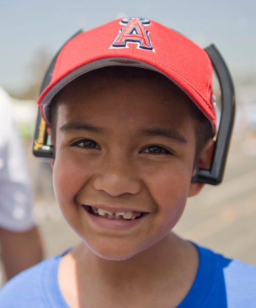 Angel Cruz, 8, of Inglewood poses for a photo during Saturday's Los Angeles Walk Now for Autism Speaks event at the Rose Bowl.