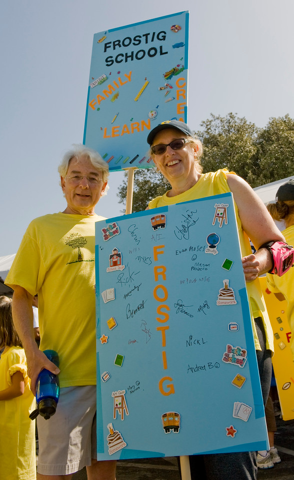 The Frostig Center's Executive Director, Bennett Ross, left, and Head of School Chris Schnieders pose for a photo during Saturday's Los Angeles Walk Now for Autism Speaks at the Rose Bowl.