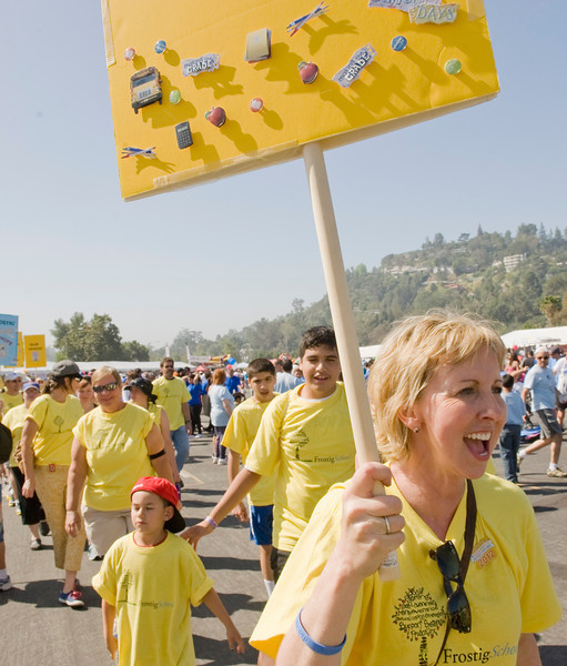 Monica Holloway leads Team Frostig to the starting line during the Walk Now for Autism Speaks event Saturday.