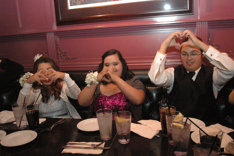 Prom Goers Emily Silvas Alexis Magallan and Omar Lara make the shape of a heart with their hands