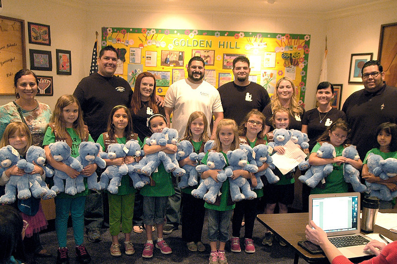 Fullerton Cares presented $18,000 to the Fullerton School District for Fullerton special education programs, gave five iPads directly to Commonwealth Elementary School representatives, and Fullerton Girl Scout Troop 2399 donated 19 Autism Speaks Build-A-Bears to Fullerton Cares, which will be donated to local children with autism, at the Fullerton School District board meeting on Tuesday, April 30, 2013 in Fullerton.