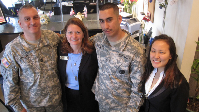 Dan Garvito, Sergeant First Class, Jae Marciano, Operation Homefront Chapter President, Gilbert Guillen, Staff Sergeant, and Sarah Lee, Representative from Loretta Sanchez's office