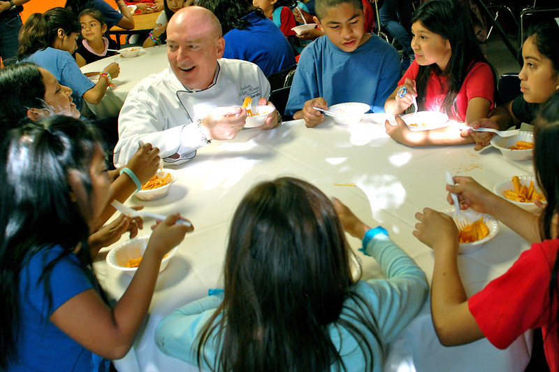 NPDOC_Outstanding Philanthropist Bruno Serato with some of the 300 motel children he feeds daily at the Boys & Girls Club of Anaheim2