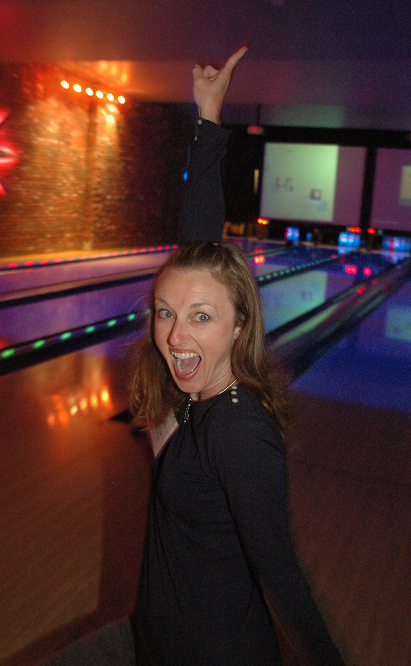 "Photo: Jess Block/ Orange Ciy News/ -11/24/07- Lisa Worrell celebrates after getting a strike Tuesday November 13, 2007. ""Bowling, Food, Drinks, and Fun!"" brought Orange County Chapter Association of Legal Administrators together with their sponsors at Lucky Strike Lanes at The Block in Orange. Photo by Jess Block/ Orange City News"
