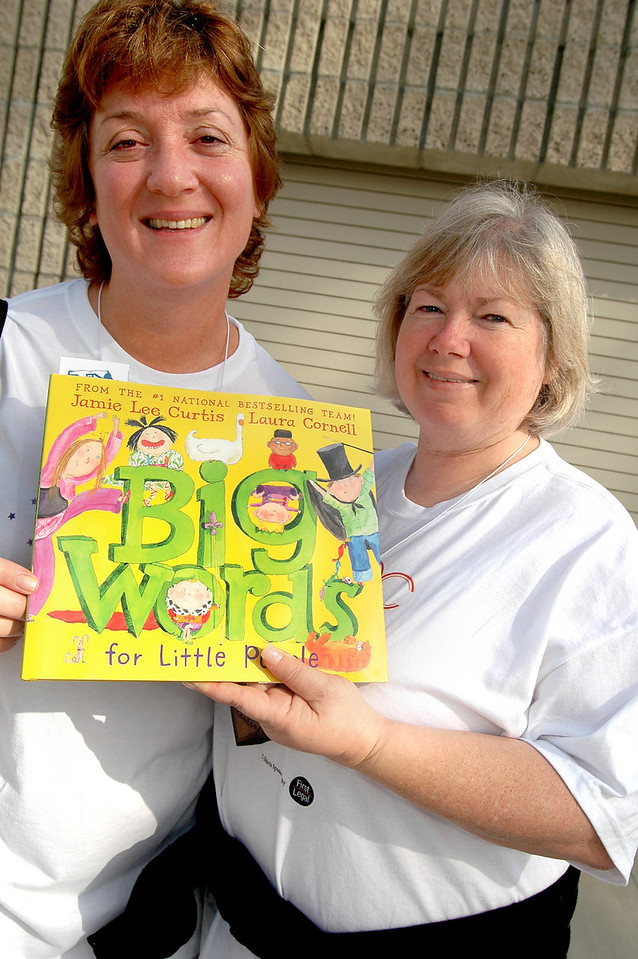 childrens book festival 7<br /> Photo:/ -10/5/08- Janet Proudfoot, committee member and Tissy Smith volunteer from the Orange County Chapter of the Association of Legal Administrators, a professional association that volunteered as a group for the Childrens' Book Festival to support childrens' literacy. The Childrens' Book Festival celebrated reading and childrens literacy with celebrity authors, exhibits, games, and live entertainments at Orange Coast College in Costa Mesa, Sunday, October 5, 2008. Photo courtesy of OC-ALA